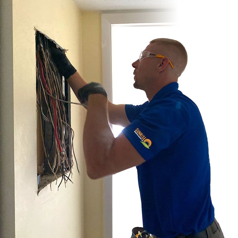 electrician installing panel